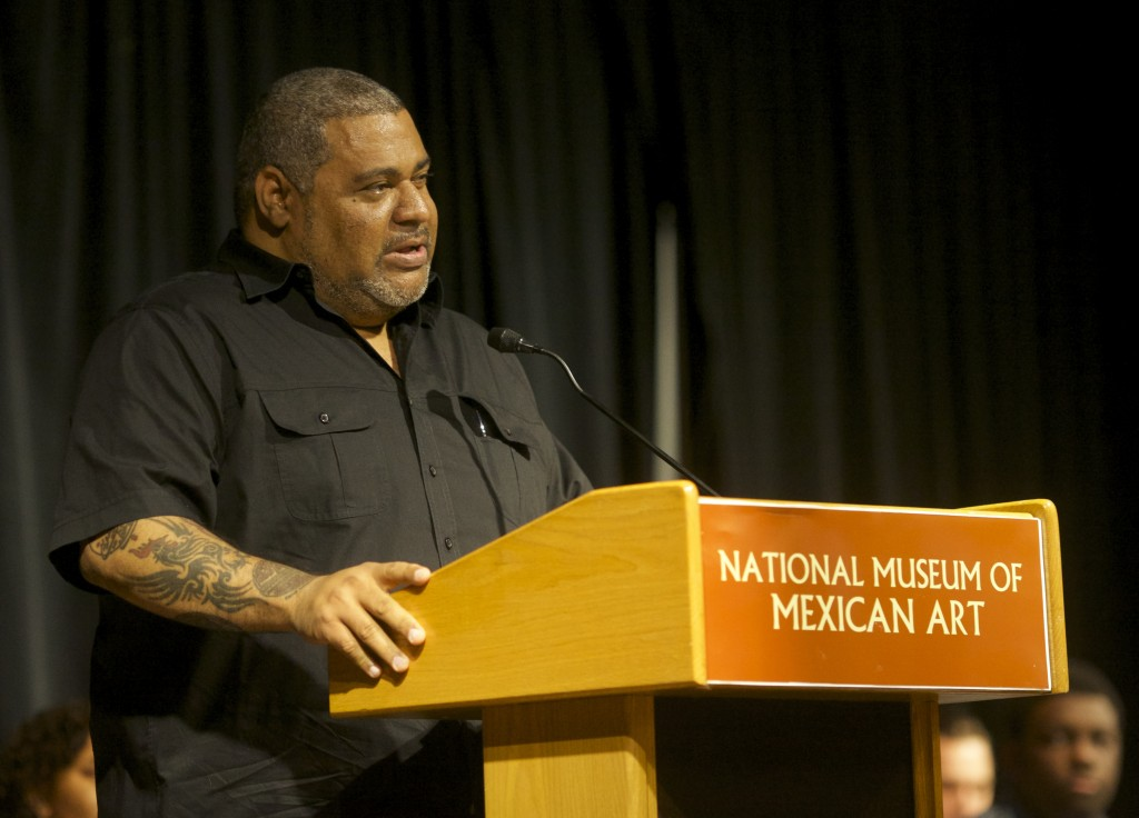 Writer, Poet, and Professor Chris Abani speaking at 2015 Odyssey Project Graduation