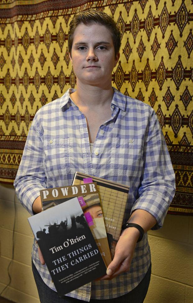 Cheryl Barnett holds texts from book group