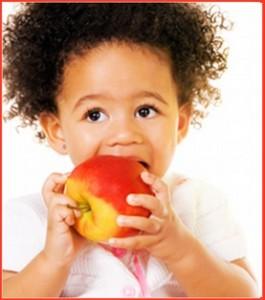 toddler eating an apple