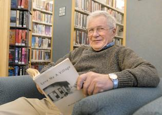 Retired Lemont High School teacher Michael Galati relaxes in a comfy chair at the Lemont Public Library Nov. 17. (Photo by Bill Ackerman)