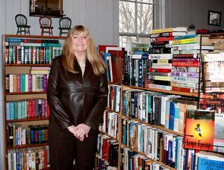 LaDonna Gass stands inside Emden's Whistle Stop Library. Photo by Nancy Rollings Saul.